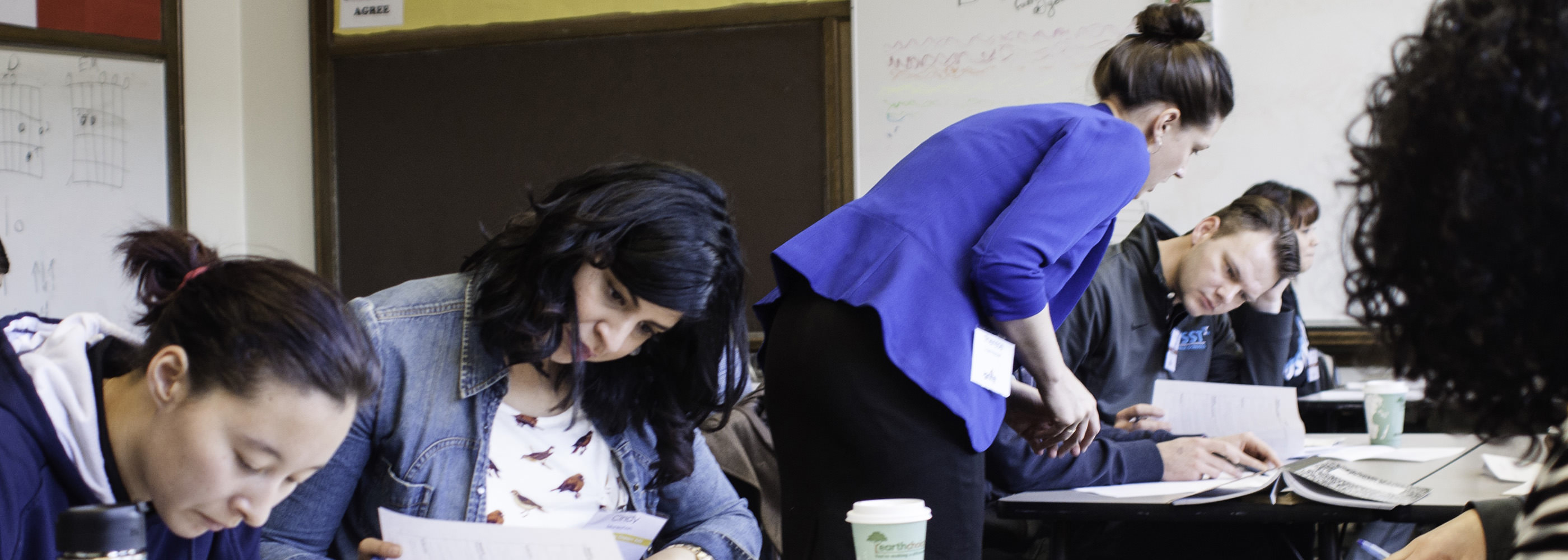 Dean of Relay Denver Therse Zosel-Harper works with teachers during a workshop.