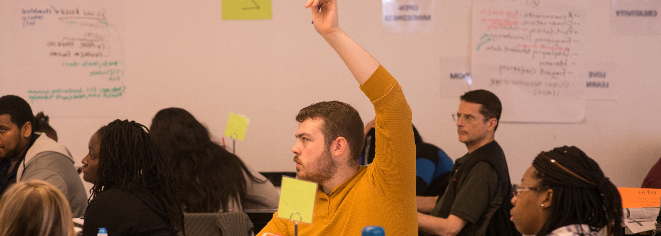 A Relay graduate student raises his hand during a special education class.