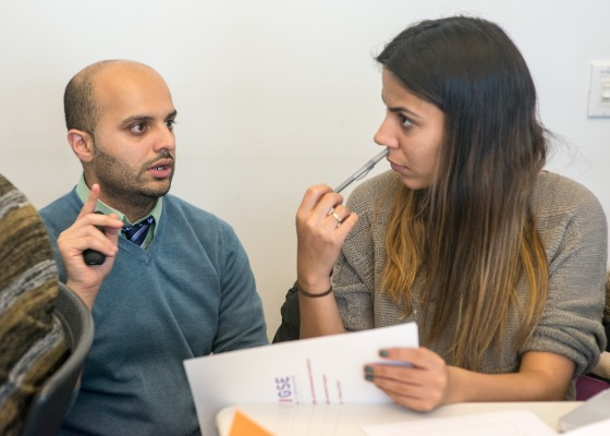 Relay special education professor Jay Maqsood works with a female graduate student during a class session.