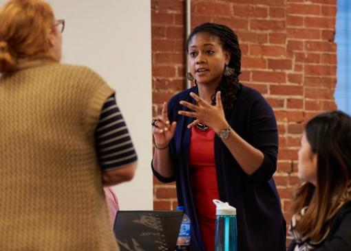Dean of Relay Philadelphia & Camden Shemanne Davis gestures enthusiastically toward graduate students during a workshop.