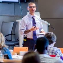 Dean Jesse Rector leads a class session.