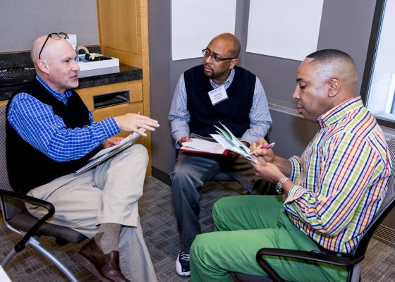 Three Principal Fellows work together on a National Principals Academy Fellowship project.